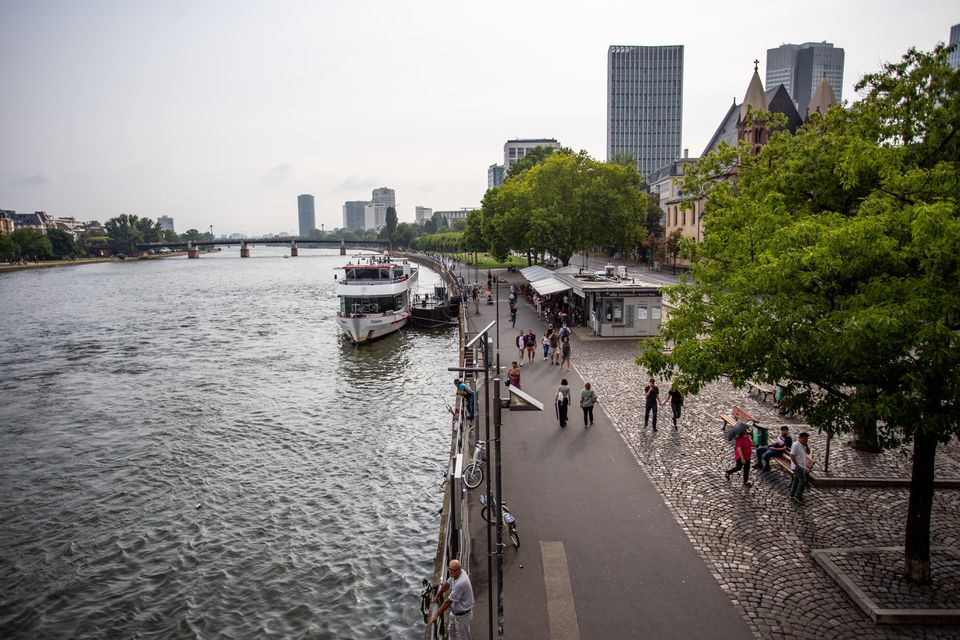 People walking along the river promenade in Frankfurt
