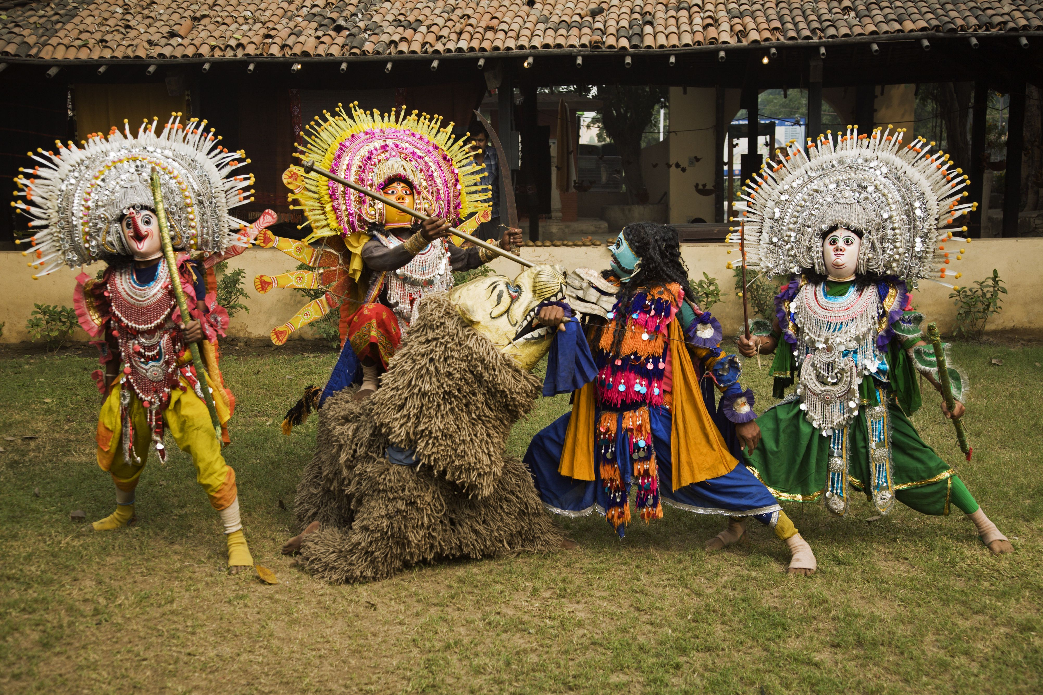 Costumed Chhau dancers (from Purulia in West Bengal) performing a traditional dance, Crafts Museum.