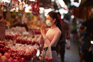 Wai at a Bangkok Market, Thailand