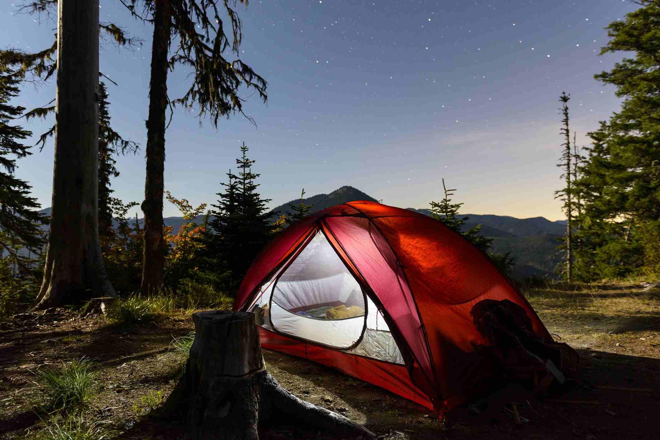 Illuminated tent on field against sky at dusk USA, Washington, Mount Rainier