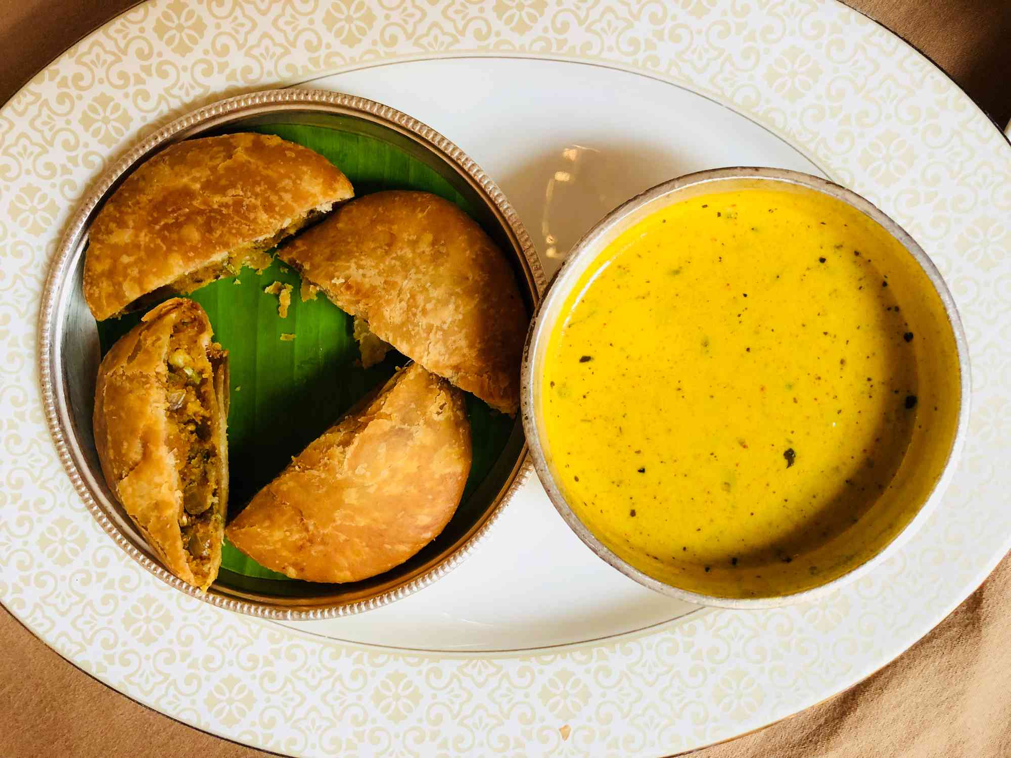 deep fried dumplings next to a bowl of yellow curry