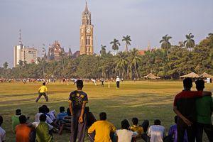 Playing cricket at Oval Maidan, Mumbai