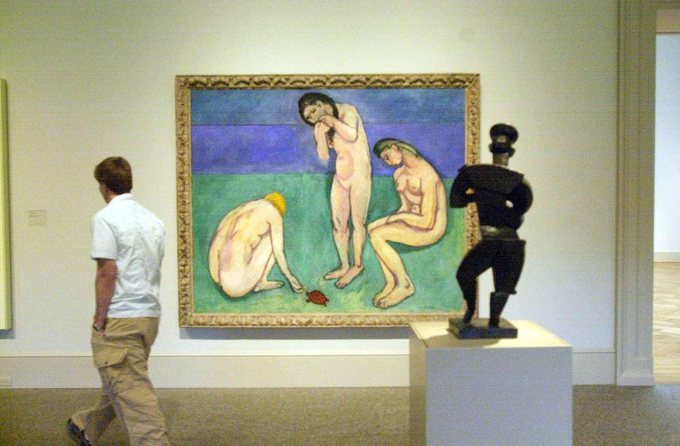 A visitor to the St. Louis Art Museum walks past Henri Matisse''s 1908 work 'Bathers With a Turtle,' April 14, 2000.
