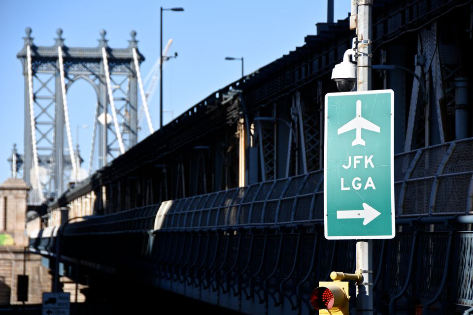 Road Sign Against Bridge And Sky In City