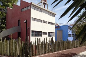 The studios of Diego Rivera and Frida Kahlo seen from the street. A cactus fence separates the property from the street.