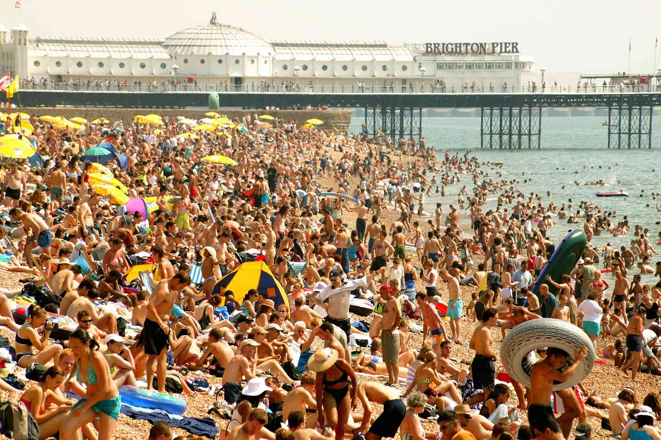 extremely crowded Brighton Beach in England