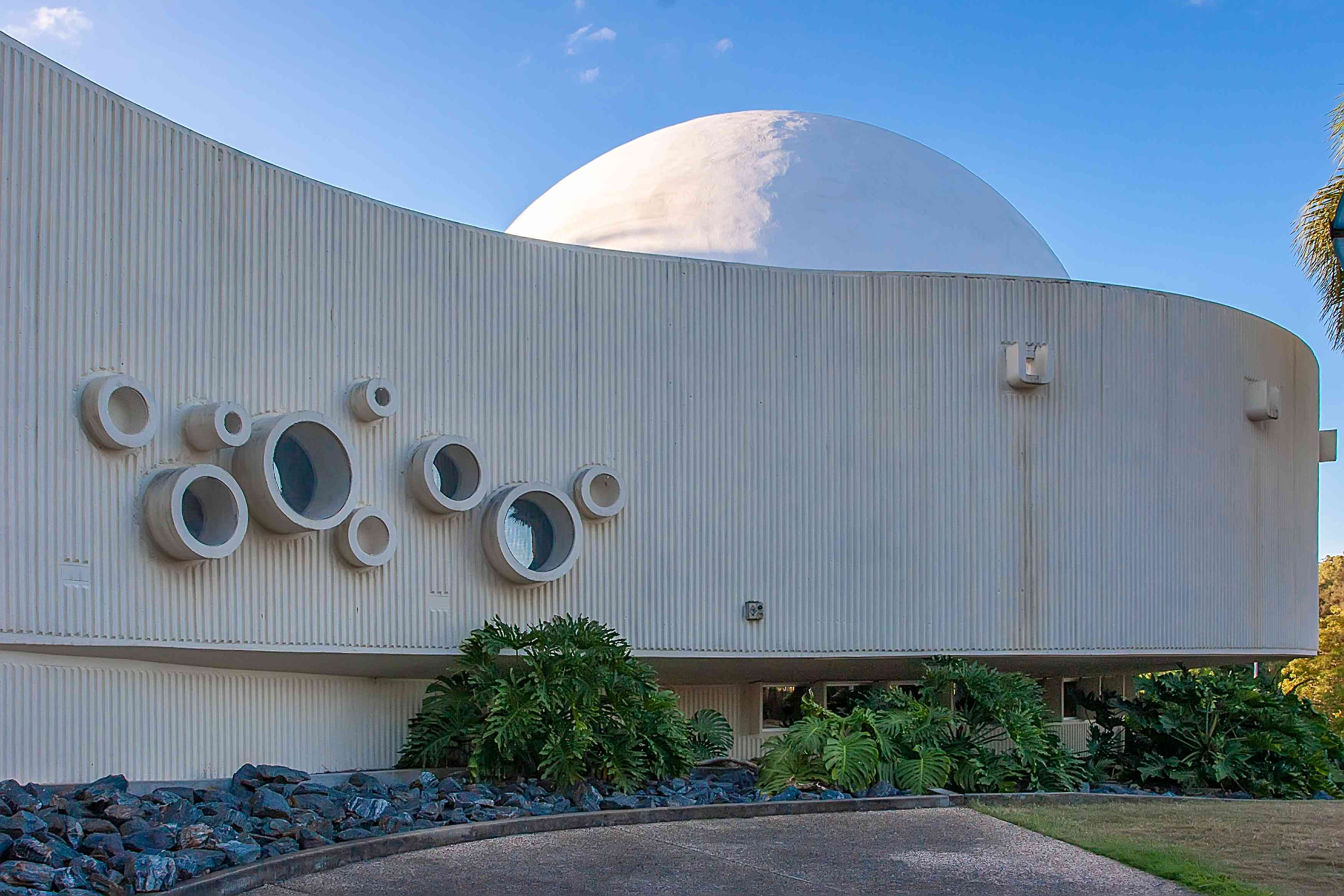White curved exterior walls at the planetarium in the Mt Coot-tha Botanical Gardens, Brisbane
