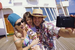 Close-up of a mid adult couple with their daughter taking a photograph of themselves