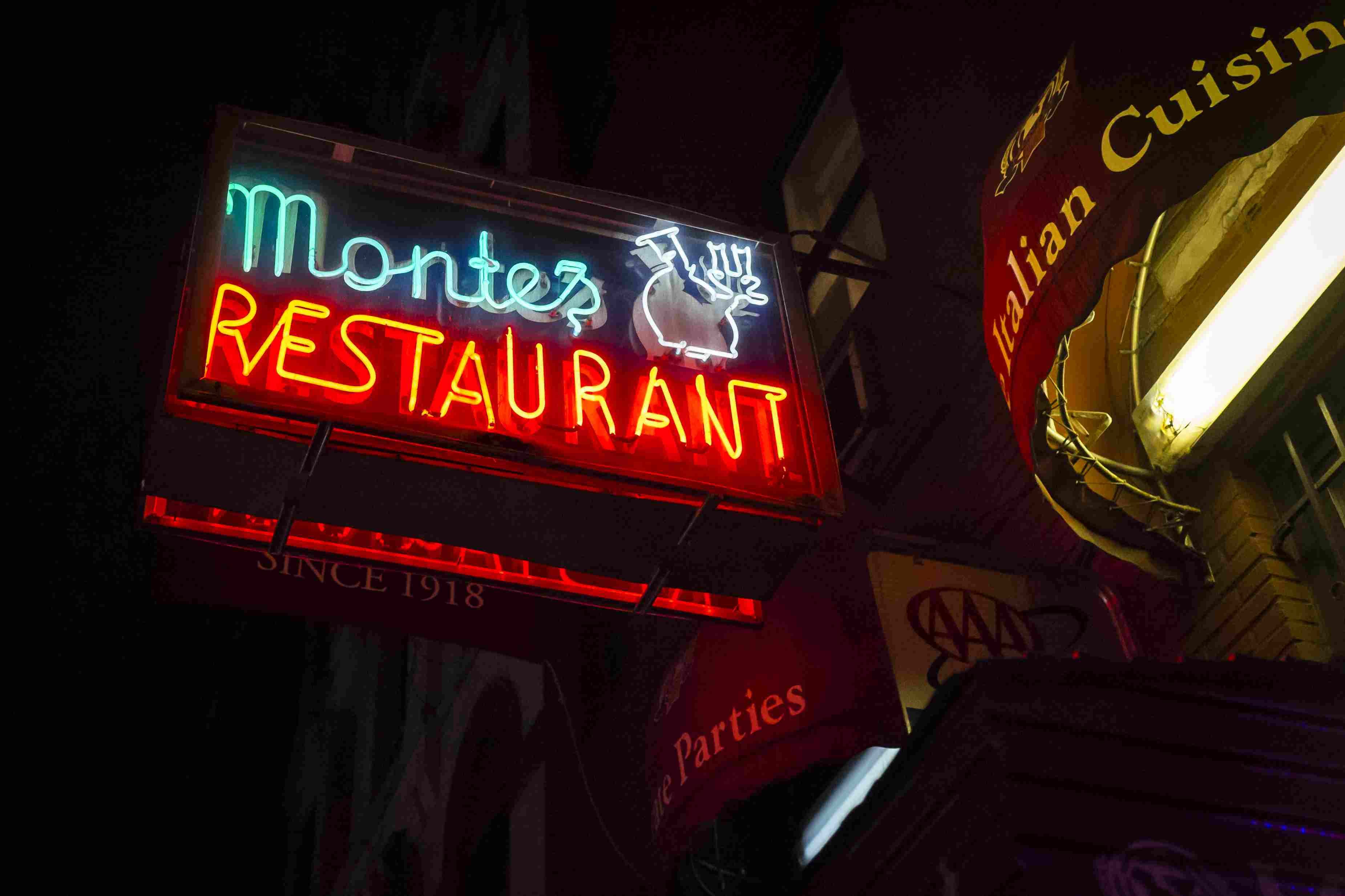 Neon sign at Monte's Restaurant lit up in New York.