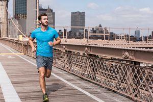 Man running across Brooklyn Bridge