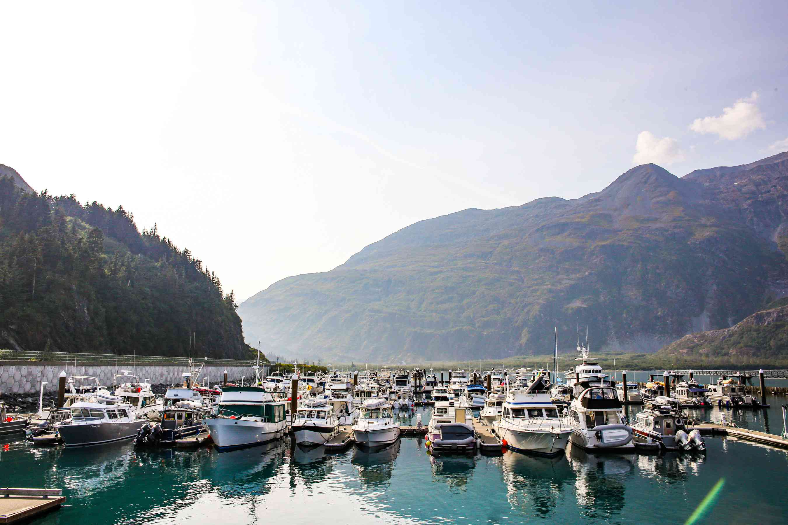 Boats docked in Whittier with mountains in the background