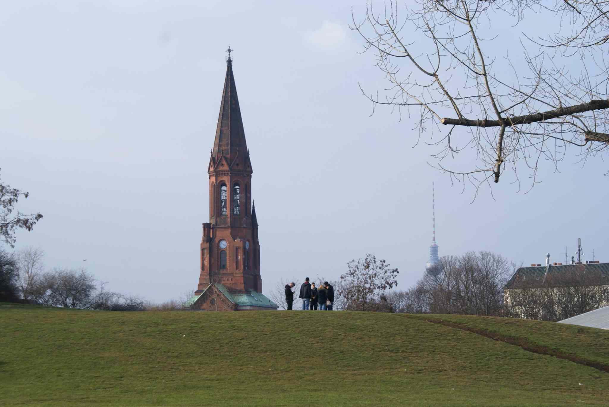 People standing on a hill in Görlitzer Park in Kreuzberg, Berlin