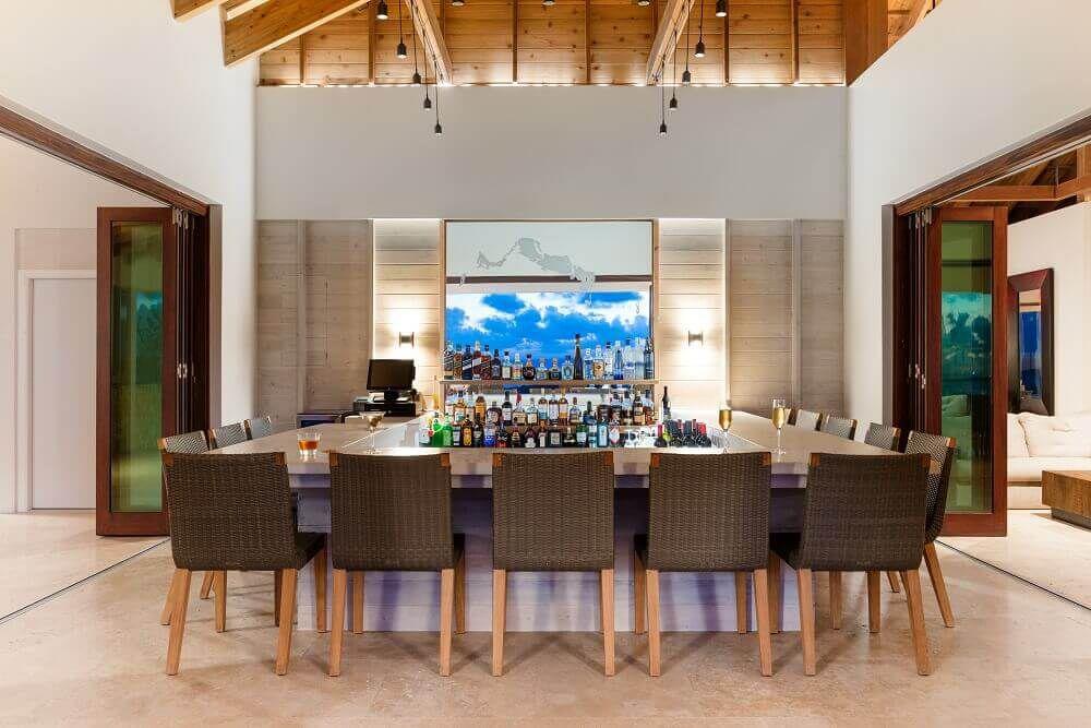 Wide three-sided bar in a brightly lit room