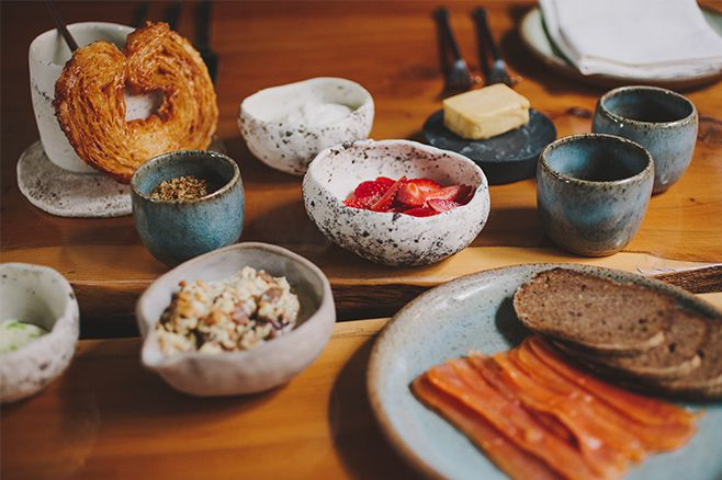 Table of breakfast food in white and blue ceramic dishes
