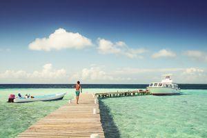 Boy walking on jetty