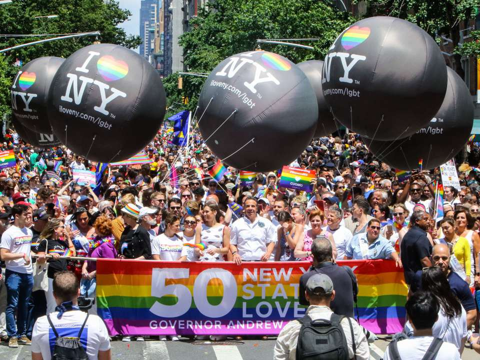 Gov. Andrew Cuomo and crowd of people marching in the NY Pride parade