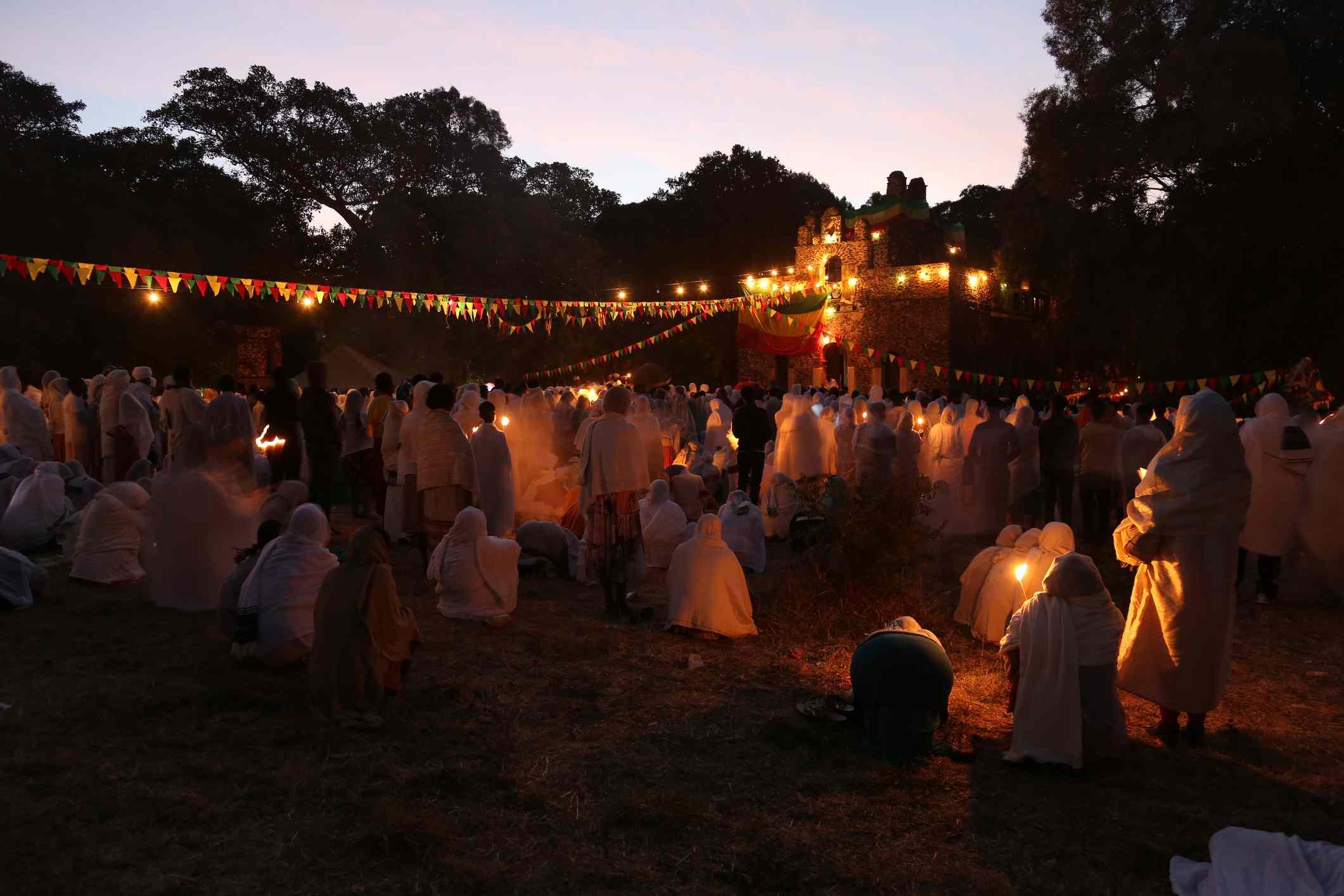 Christians hold a candlelit vigil during the Timket festival in Gondar