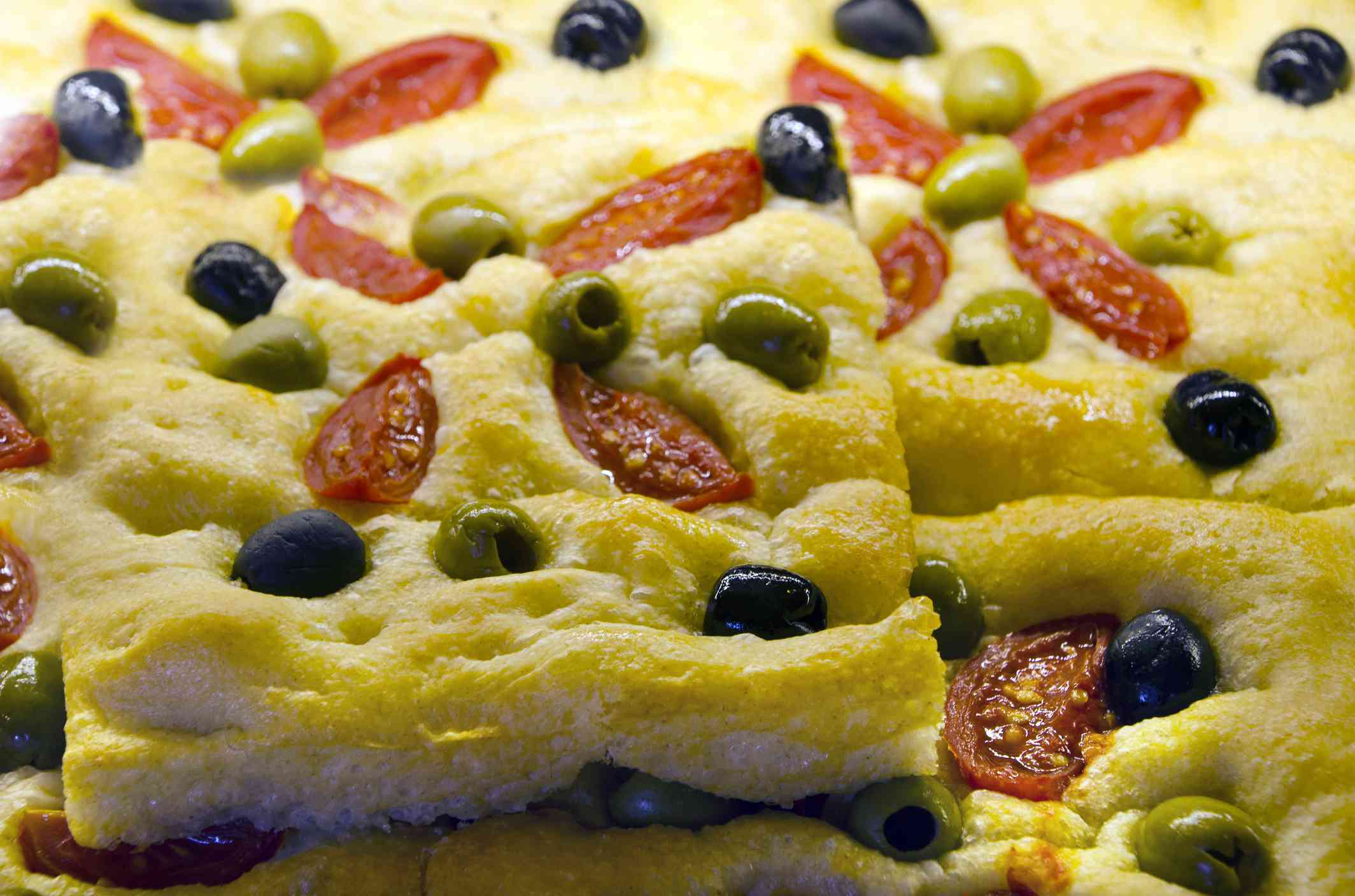 Close-up of focaccia with olives and tomatoes