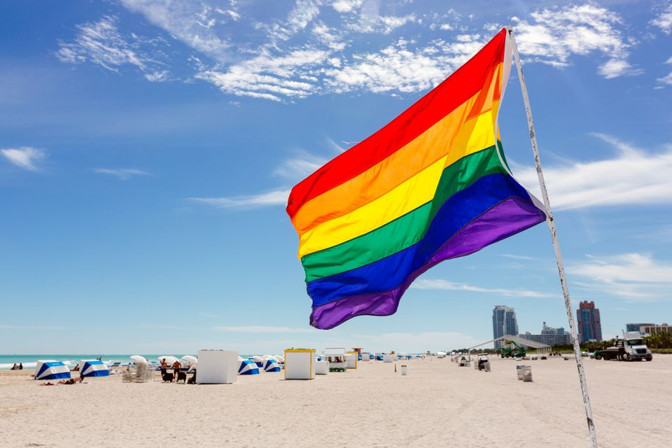 Rainbow flag on the beach in South Beach, Miami, USA