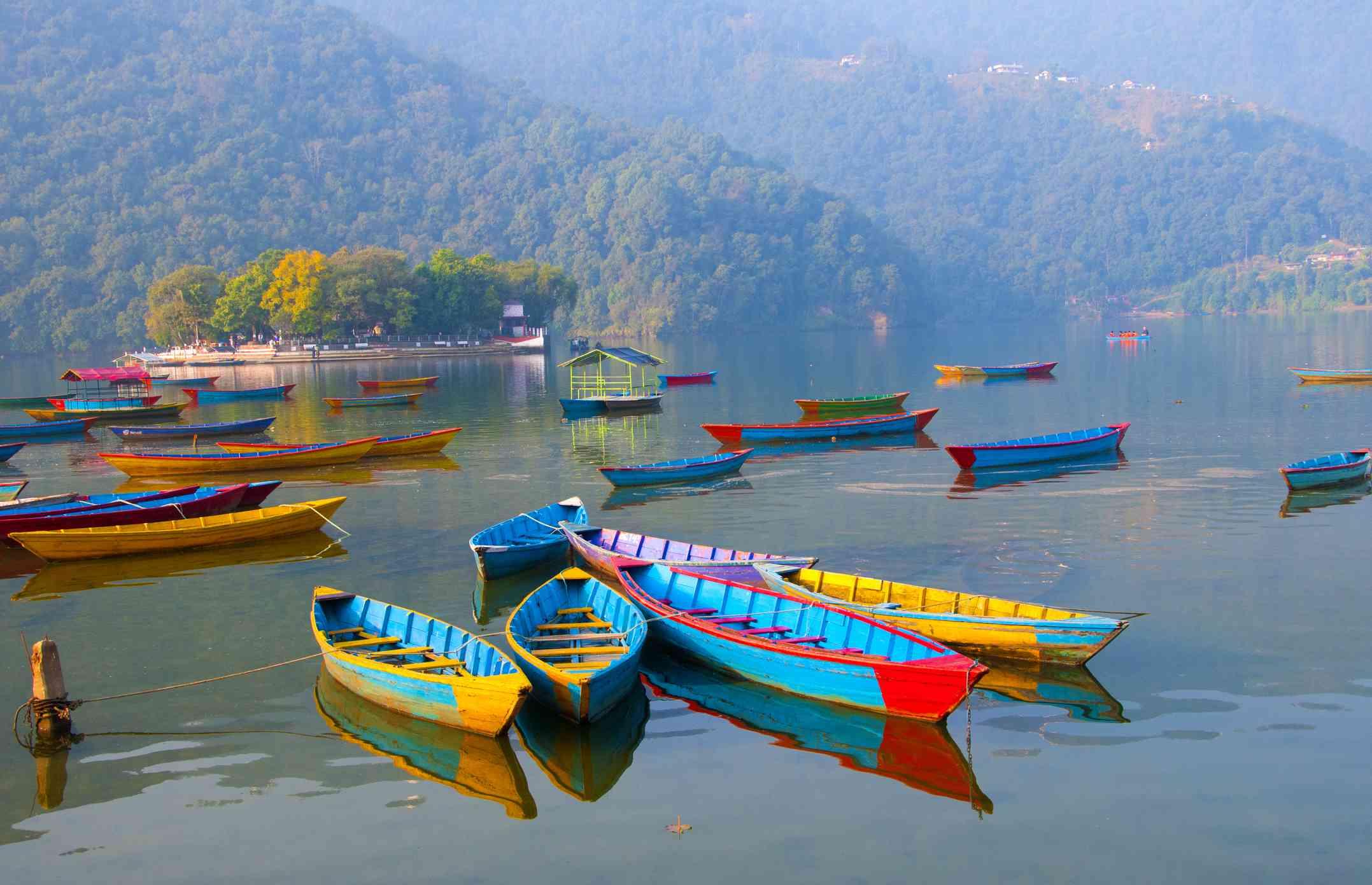 Colourful Wooden pleasure boats in Phewa Lake, Pokhara, Nepal