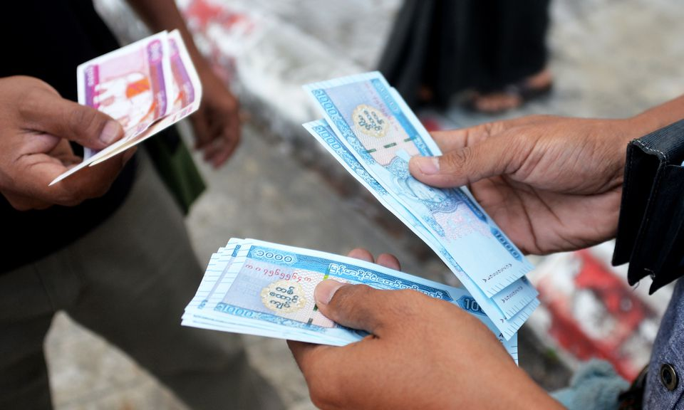 Money in Myanmar exchanging hands
