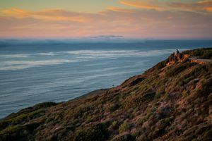 A cliffside in San Diego overlooking the water during sunset