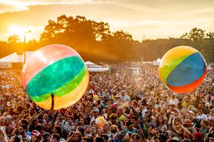 Crowd playing with giant beach balls at Bonnaroo