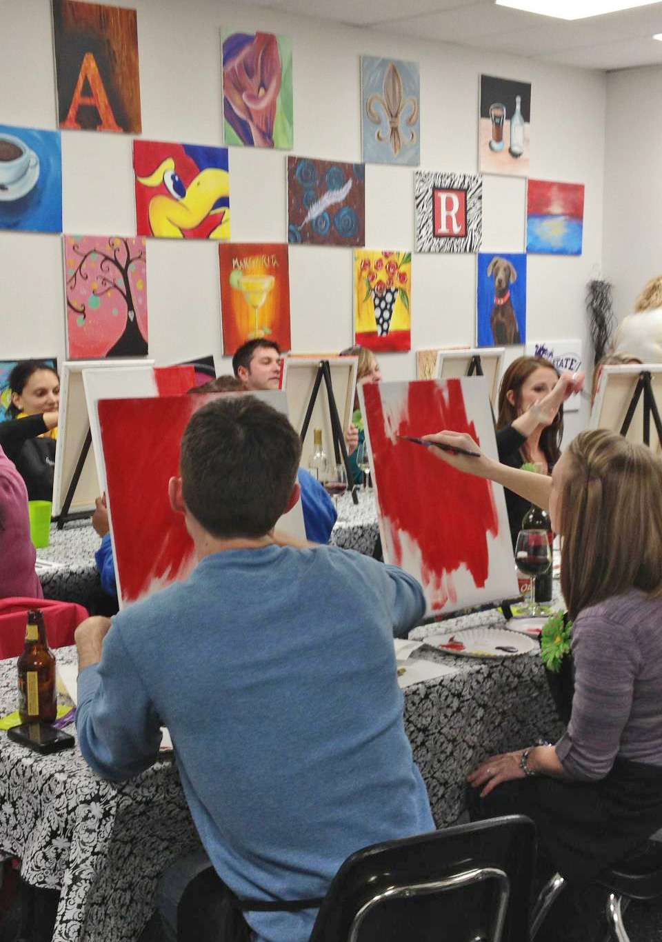 Grapes and Paints wine painting class