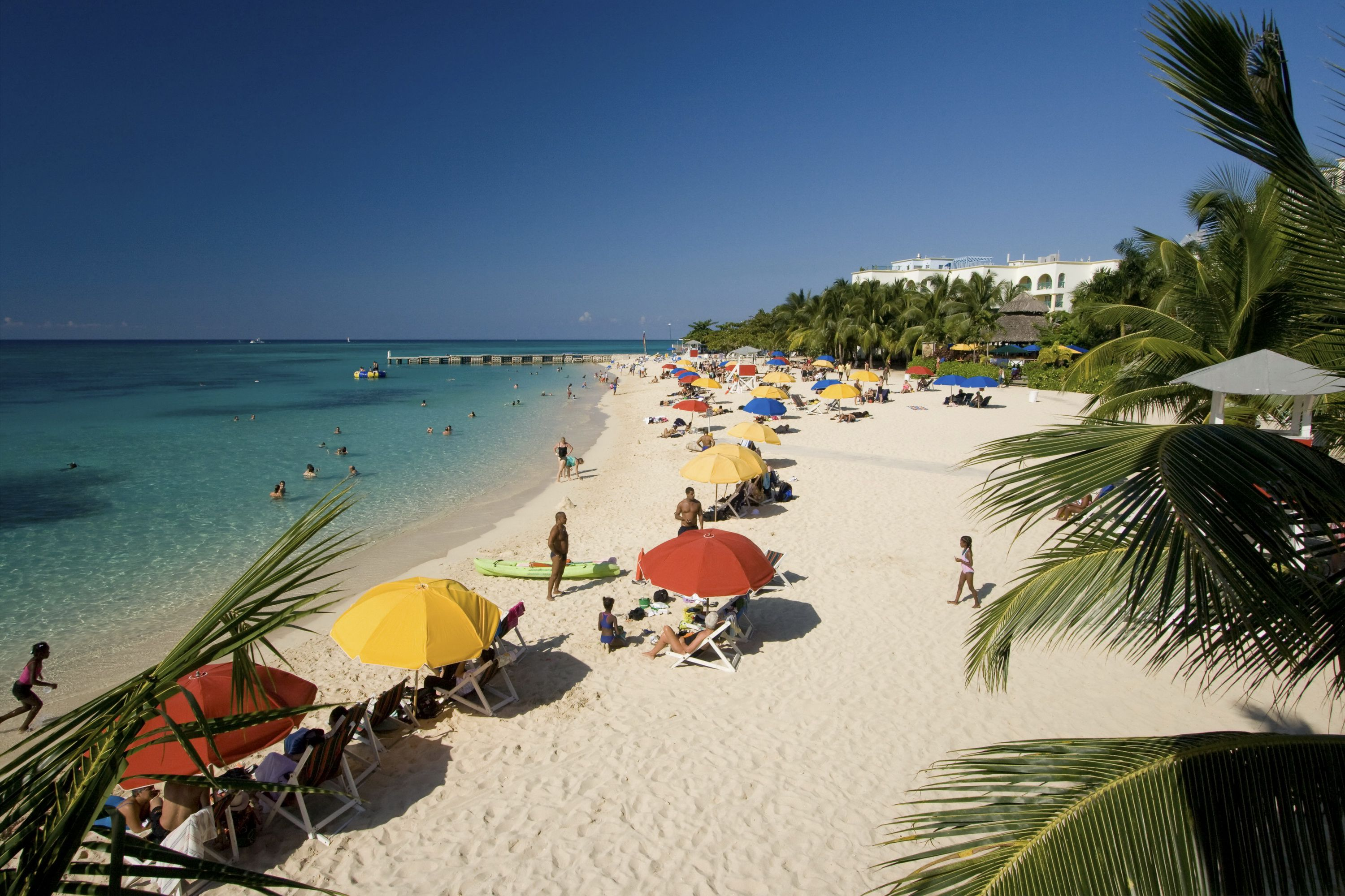 People lounging on the beach in Montego Bay, Jamaica