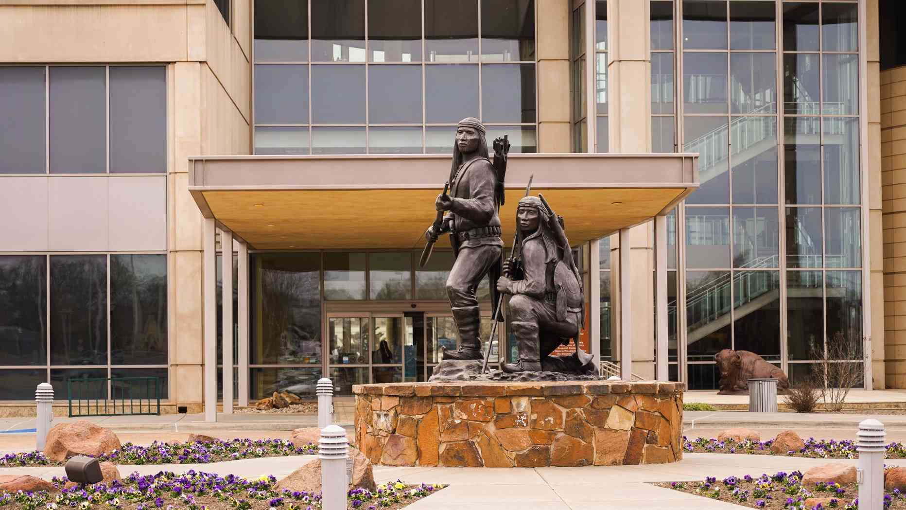 Statue of two Native American hunters in front of the Oklahoma History Center