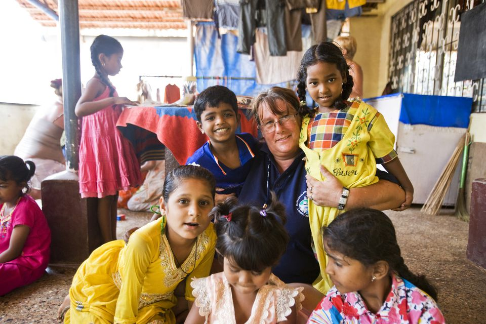 Children with foreign volunteer at centre for disadvantaged children in India.