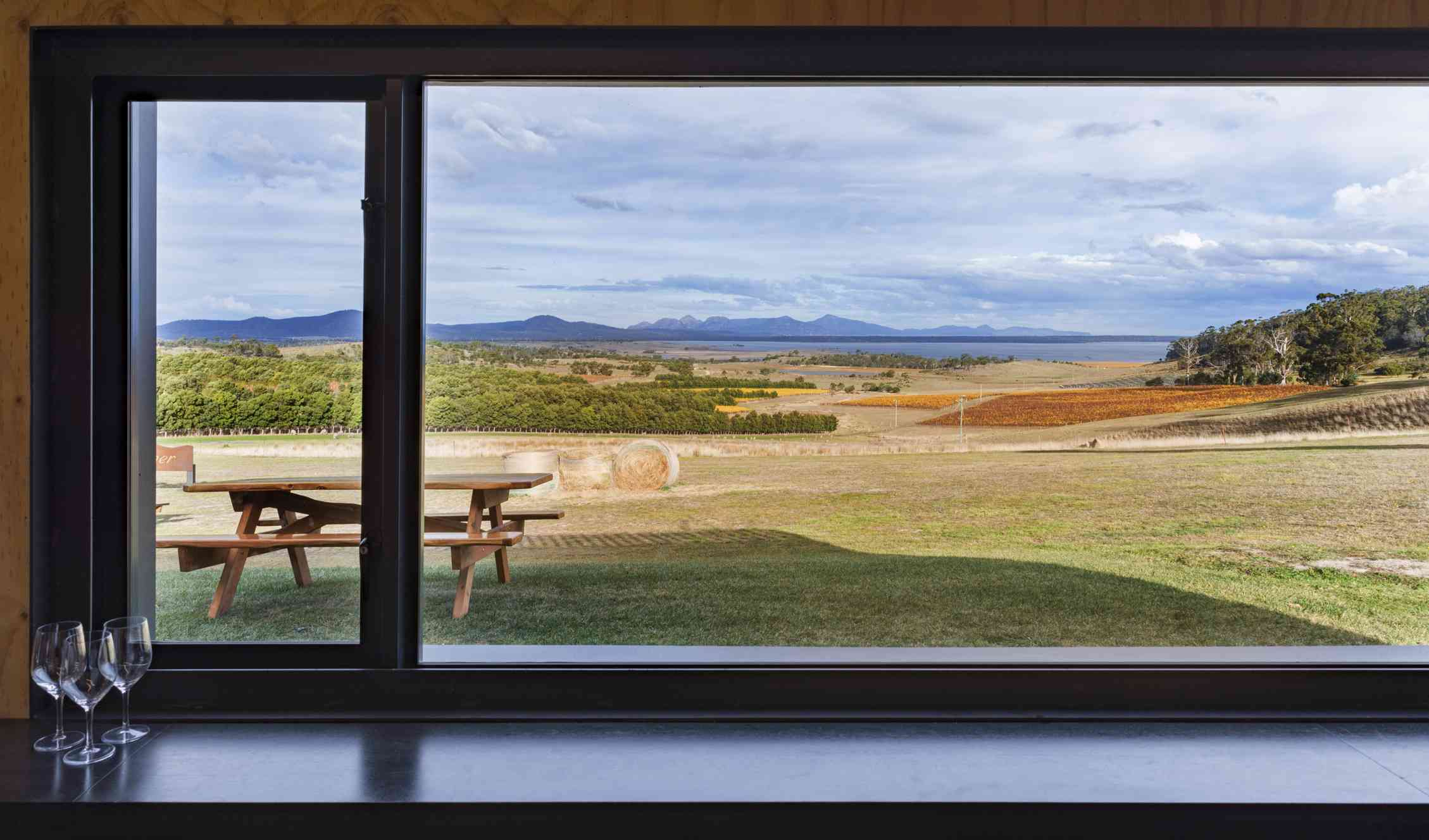 Cellar door with views over nearby lake and mountains