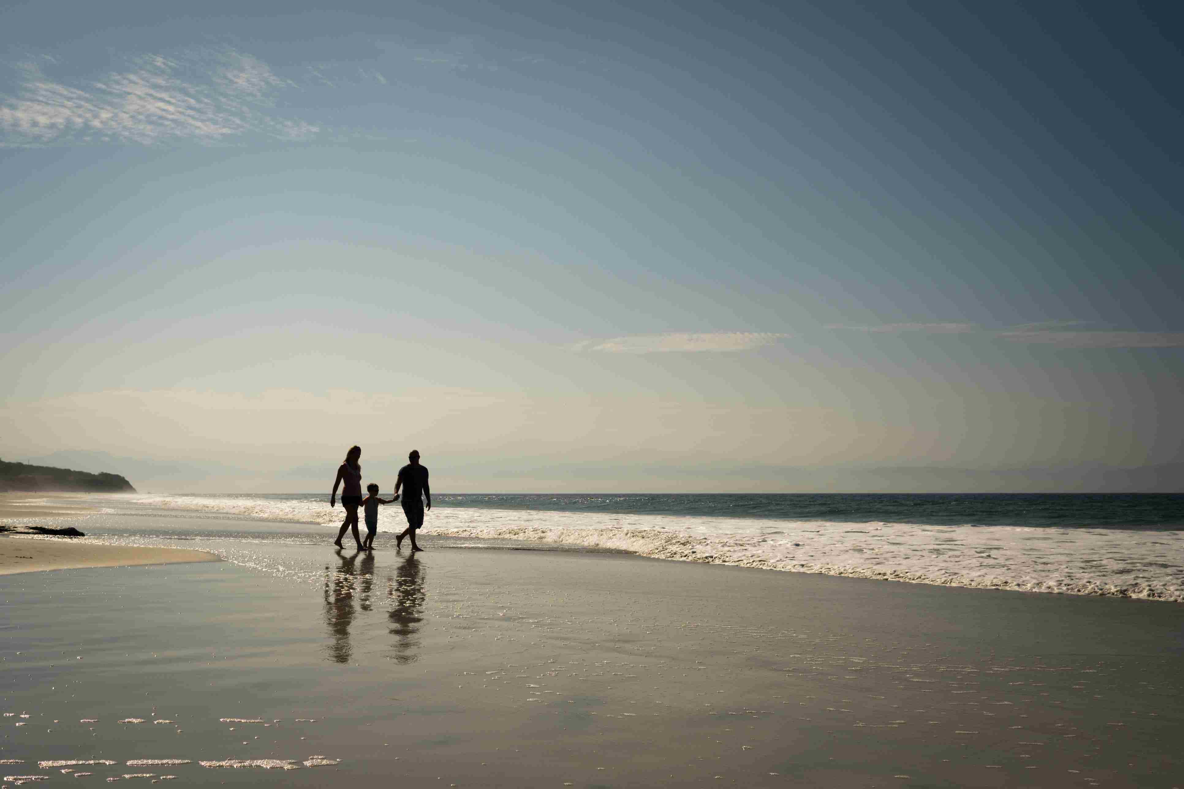Mexico, Riviera Nayarit, family walking on the beach