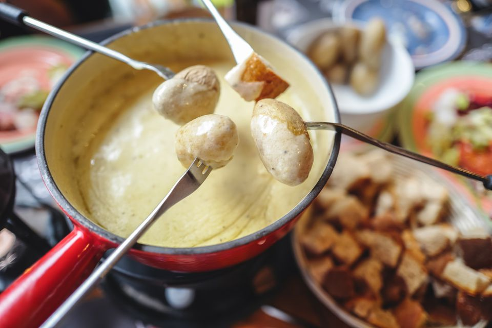 Fondue pot with bread and potatoes