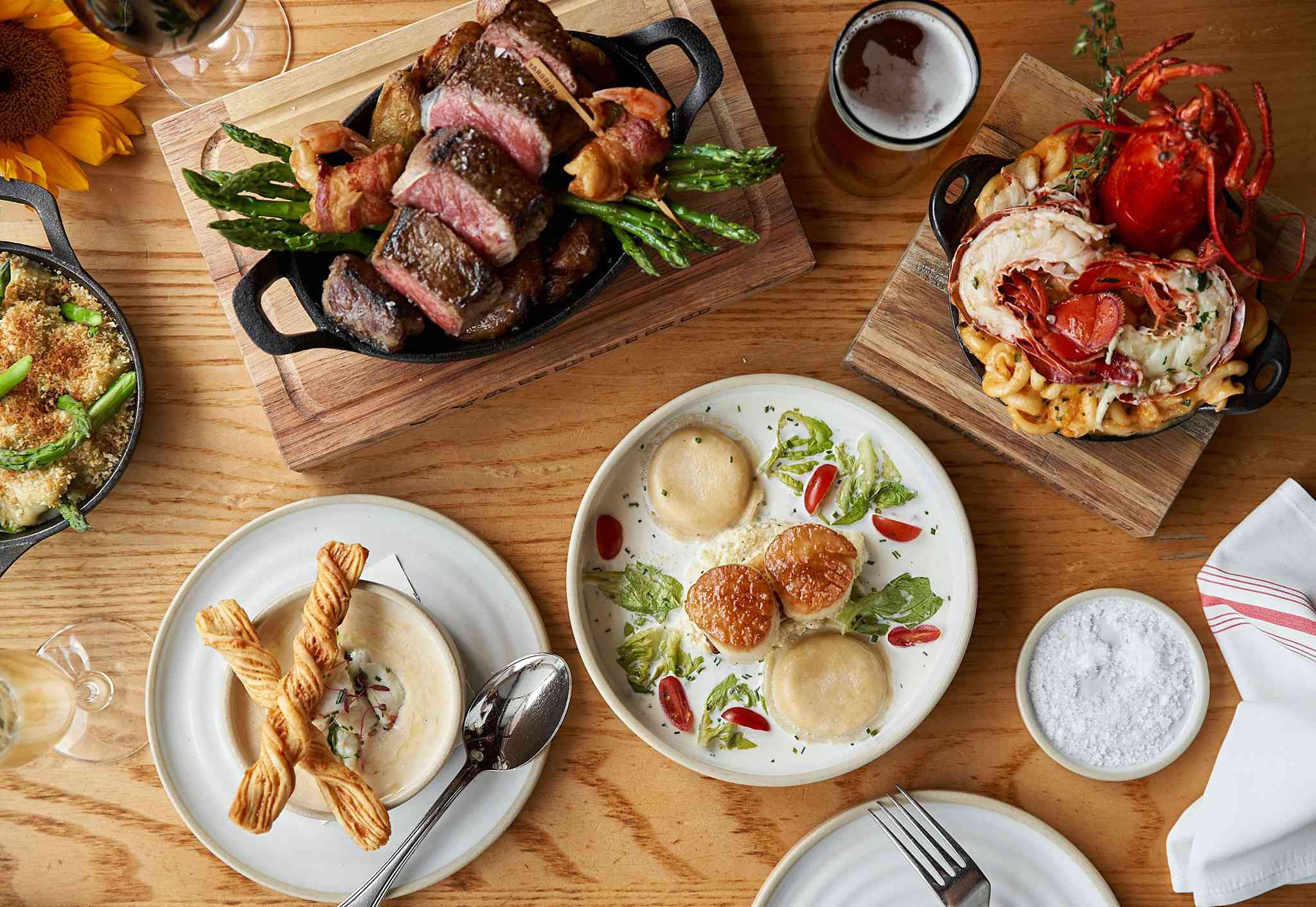 A table filled with different professionally plated dishes from Yardbird