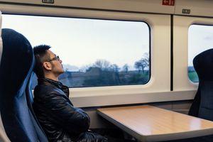 man sitting on the train in Edinburgh