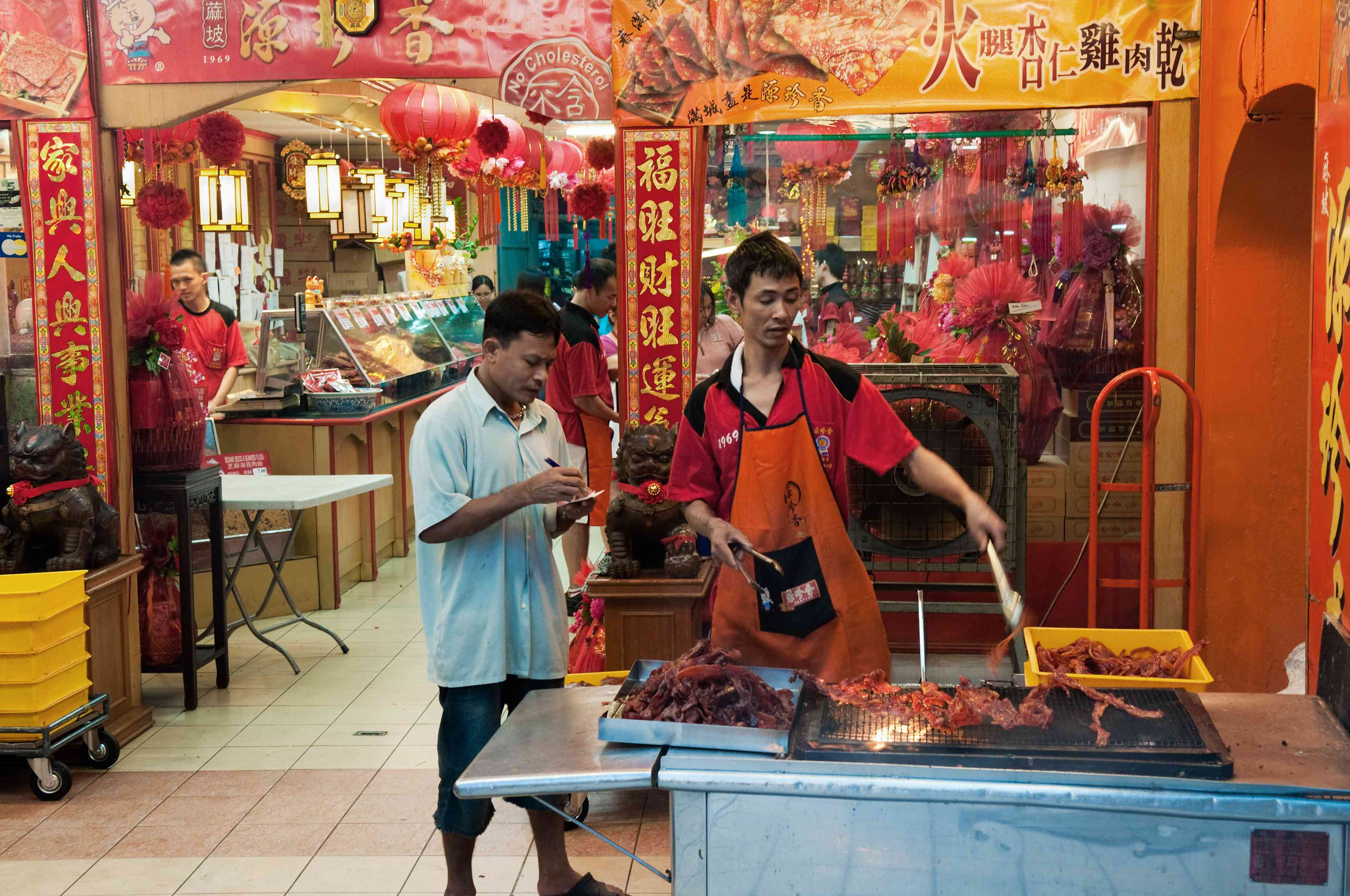 Man cooking in Chinatown, Kuala Lumpur