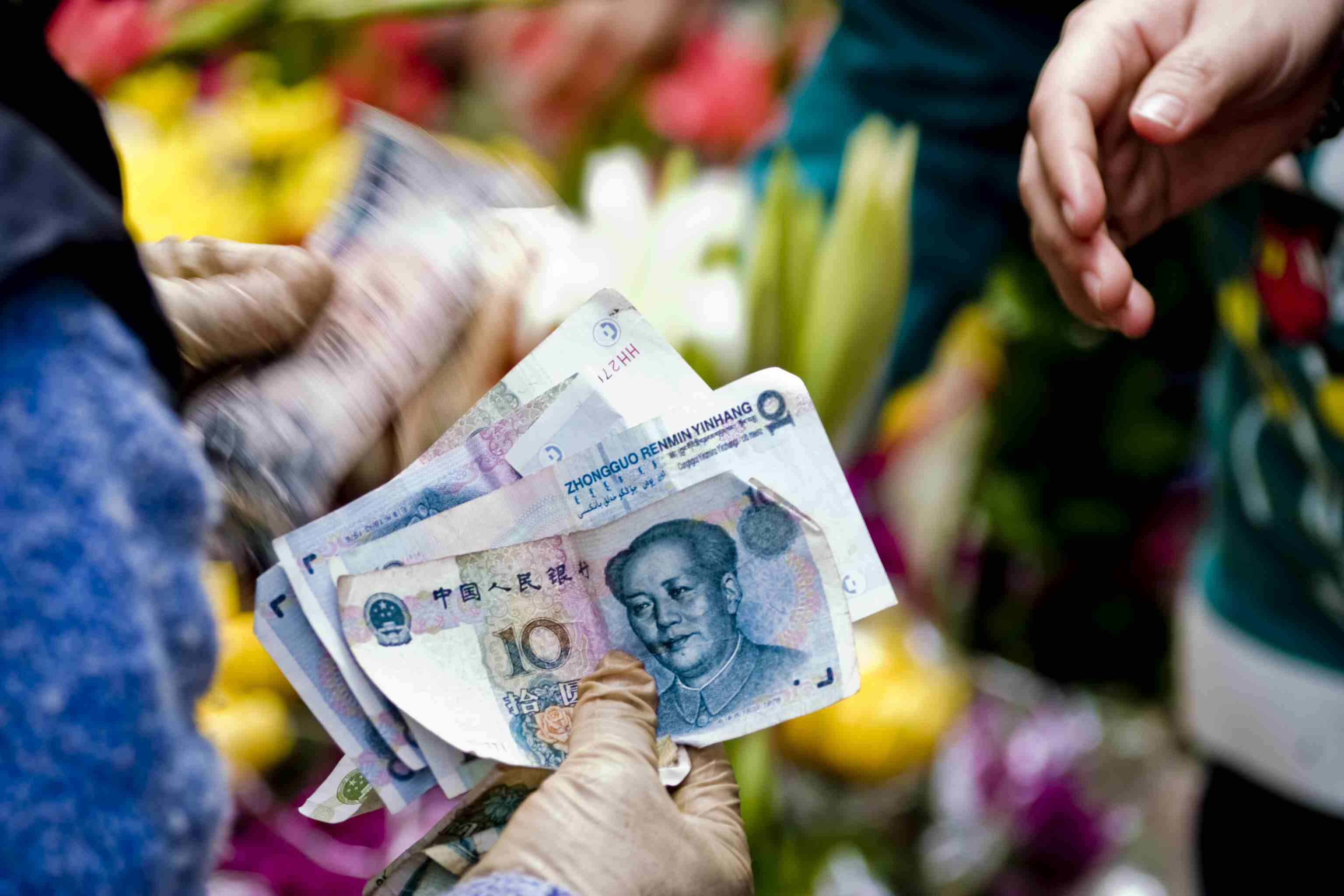 Chinese money exchganging hands