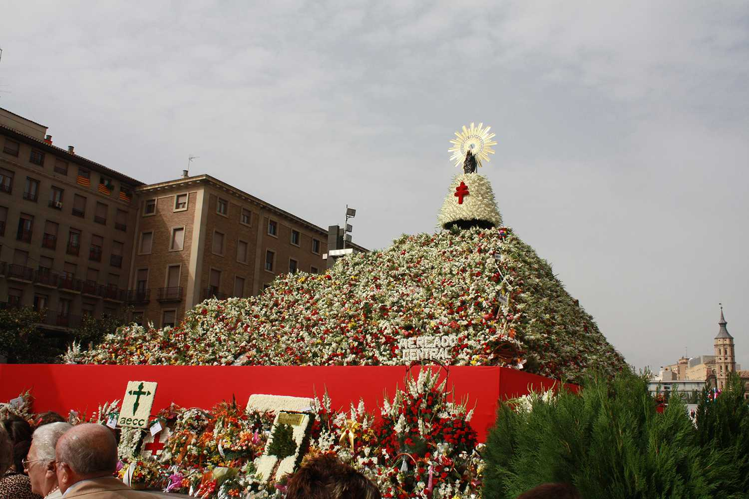 Altar piled high with flowers for Fiestas del Pilar