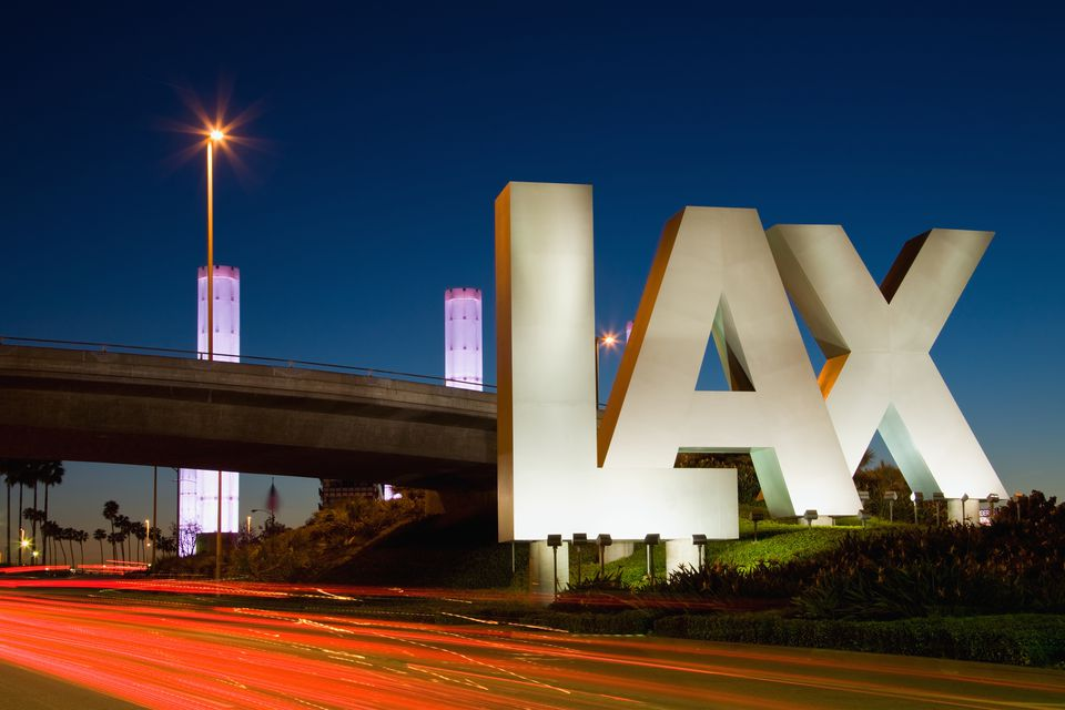 USA, California, Los Angeles, Road to International Los Angeles Airport, illuminated LAX sign