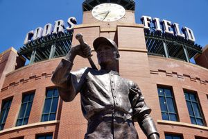 Exterior Coors Field with a statue