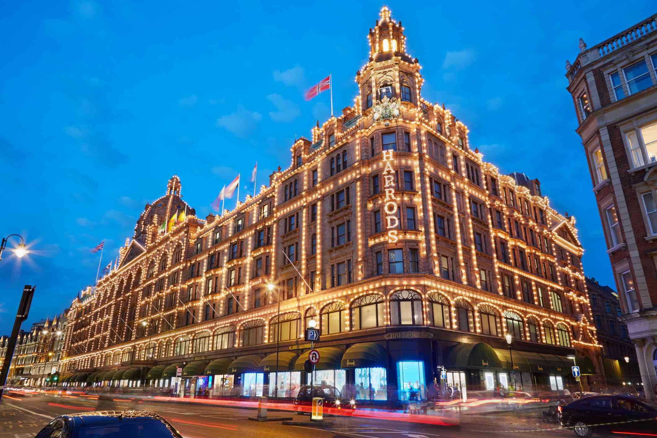 Harrods department store illuminated in the evening