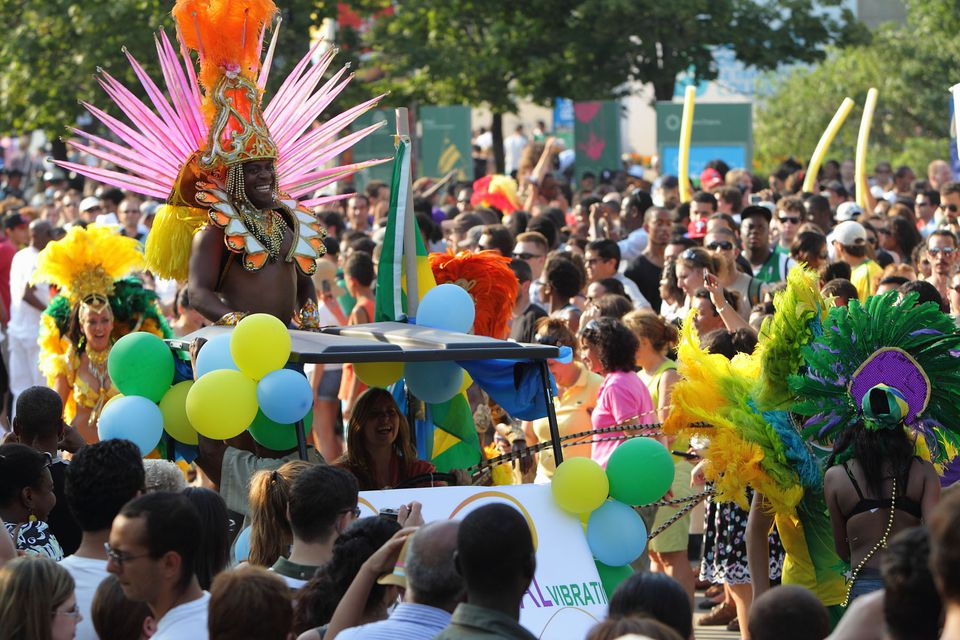 Revelers enjoy the Carifiesta parade in Montreal, Quebec