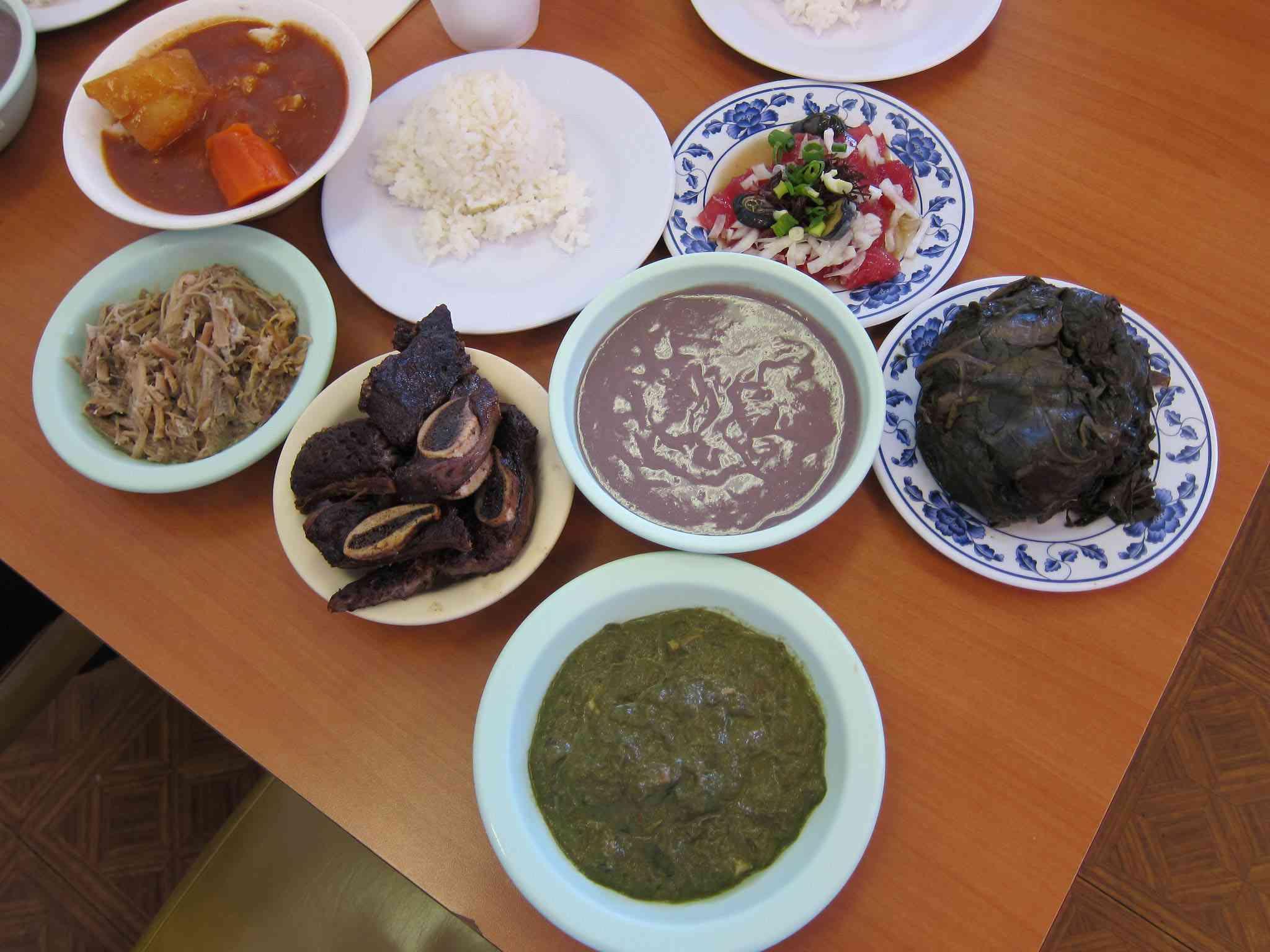 Helena's Hawaiian Food—From top left, counter clockwise—Tripe Stew, Rice, Opihi Poke, Laulau, Squid Luau, Pipikaula Shortribs, Kalua Pig and Poi in the center