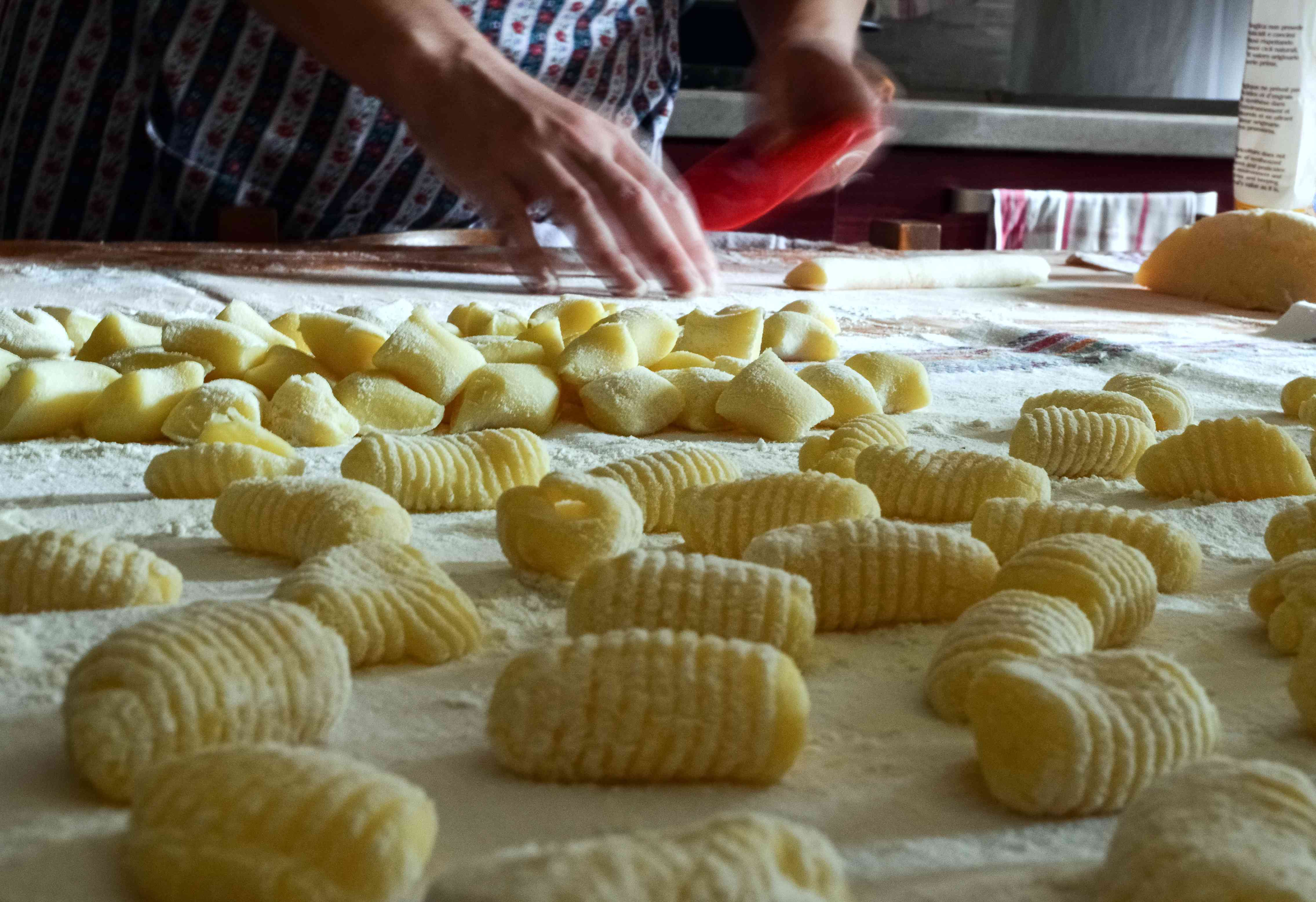 Traditional homemade preparation of fresh, handmade potato gnocchi pasta
