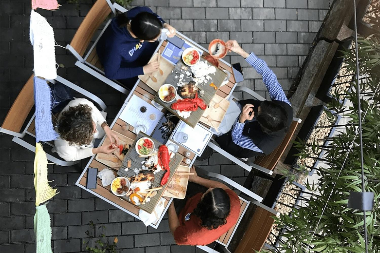 A family having dinner at Tanám in Boston