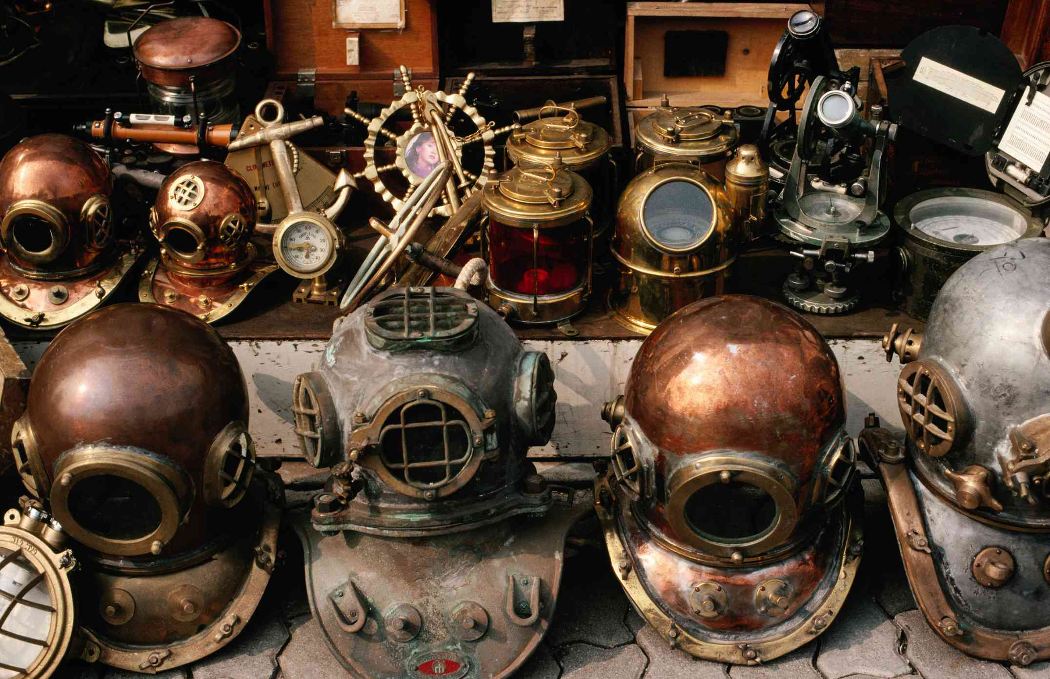 Diving helmets and other old maritime artifacts for sale at Itaewon