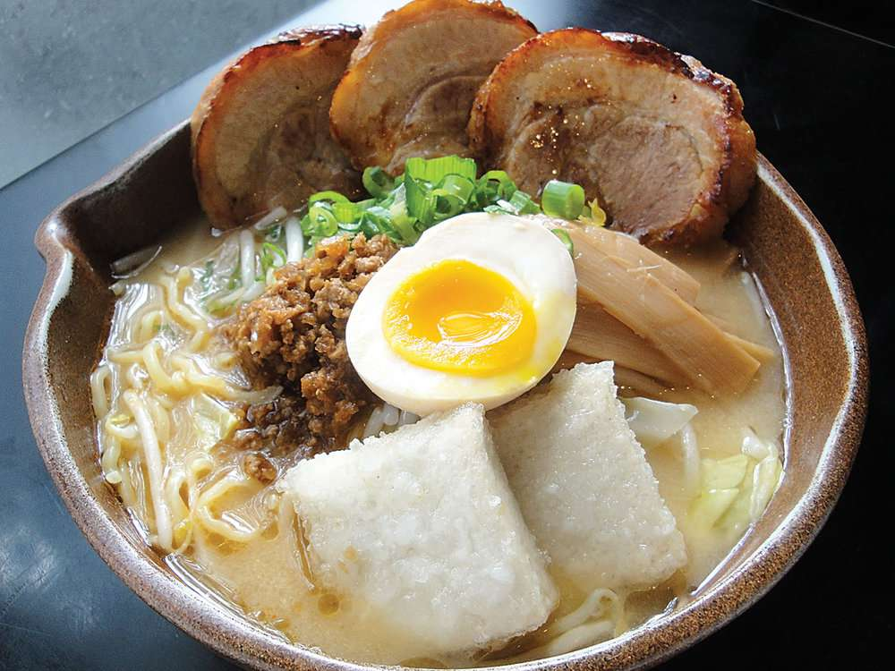 Miso ramen with pork, half an egg, bamboo shoots and scallions from Misoya