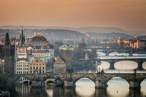 Czech Republic, Prague, cityscape with Charles Bridge at dawn