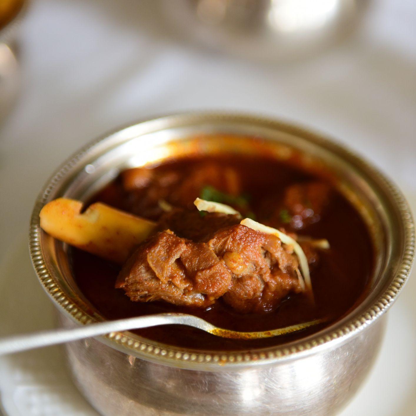 mutton stew in a metal bowl